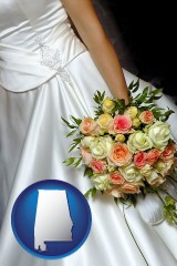 alabama a bride, wearing a white wedding dress and holding a beautiful bridal bouquet