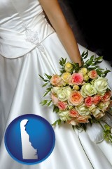 delaware a bride, wearing a white wedding dress and holding a beautiful bridal bouquet