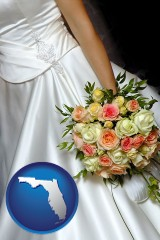 florida a bride, wearing a white wedding dress and holding a beautiful bridal bouquet