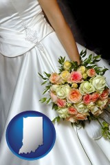indiana a bride, wearing a white wedding dress and holding a beautiful bridal bouquet