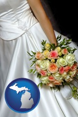 michigan a bride, wearing a white wedding dress and holding a beautiful bridal bouquet