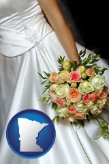 minnesota a bride, wearing a white wedding dress and holding a beautiful bridal bouquet