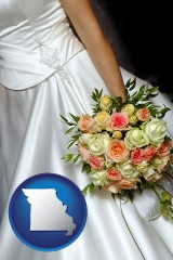 missouri a bride, wearing a white wedding dress and holding a beautiful bridal bouquet