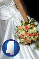 mississippi a bride, wearing a white wedding dress and holding a beautiful bridal bouquet