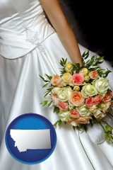 montana a bride, wearing a white wedding dress and holding a beautiful bridal bouquet