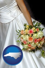 north-carolina a bride, wearing a white wedding dress and holding a beautiful bridal bouquet