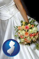 new-jersey a bride, wearing a white wedding dress and holding a beautiful bridal bouquet