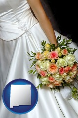 new-mexico a bride, wearing a white wedding dress and holding a beautiful bridal bouquet