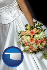 oklahoma a bride, wearing a white wedding dress and holding a beautiful bridal bouquet