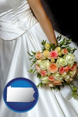 pennsylvania a bride, wearing a white wedding dress and holding a beautiful bridal bouquet
