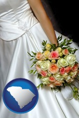 south-carolina a bride, wearing a white wedding dress and holding a beautiful bridal bouquet
