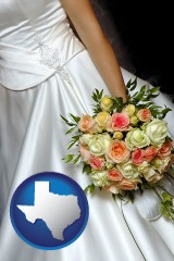 texas a bride, wearing a white wedding dress and holding a beautiful bridal bouquet