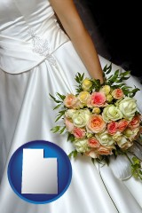 utah a bride, wearing a white wedding dress and holding a beautiful bridal bouquet