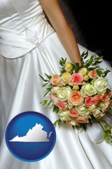 virginia a bride, wearing a white wedding dress and holding a beautiful bridal bouquet