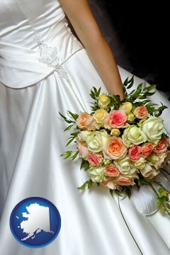 a bride, wearing a white wedding dress and holding a beautiful bridal bouquet - with Alaska icon