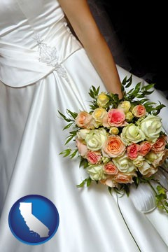 a bride, wearing a white wedding dress and holding a beautiful bridal bouquet - with California icon