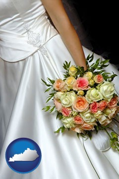 a bride, wearing a white wedding dress and holding a beautiful bridal bouquet - with Kentucky icon
