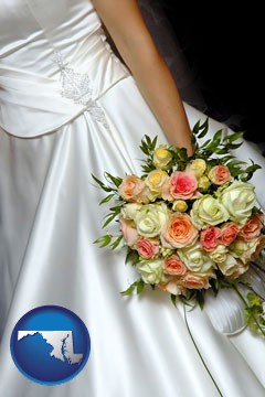a bride, wearing a white wedding dress and holding a beautiful bridal bouquet - with Maryland icon