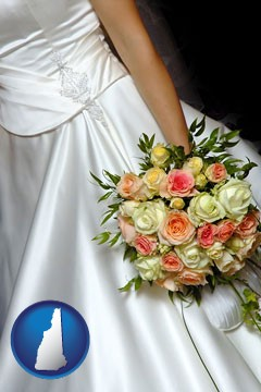 a bride, wearing a white wedding dress and holding a beautiful bridal bouquet - with New Hampshire icon