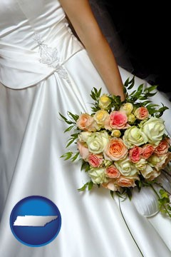 a bride, wearing a white wedding dress and holding a beautiful bridal bouquet - with Tennessee icon