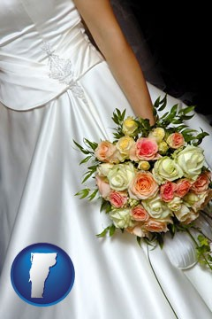 a bride, wearing a white wedding dress and holding a beautiful bridal bouquet - with Vermont icon